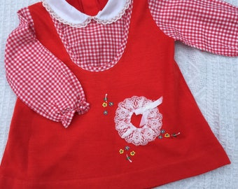 Vintage/retro/mod baby/toddler swing dress with attached gingham shirt and flower embroidery. Approx size 6-12 months.