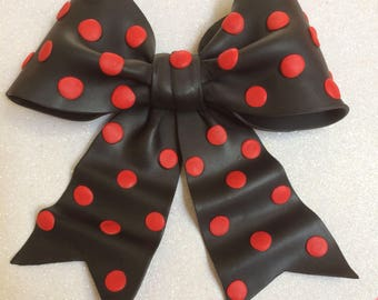 Edible black bow with red polka dots gum paste fondant for birthday cake