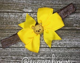 Winnie the Pooh bow on adjustable headband