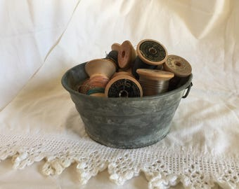 13 Large Vintage Wooden Spools of Thread in Galvanized Tub