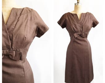 Classy 1950's René Originals tailored brown dress with bow under the bust. Size M/L.