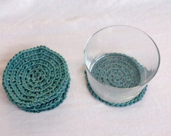 8 green and grey crochet coasters