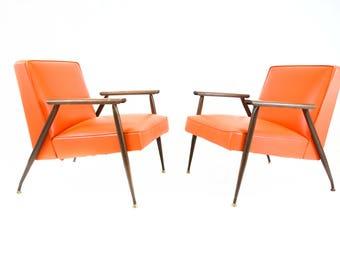 Mid Century Modern Orange Vinyl Lounge Chairs by Viko Baumritter