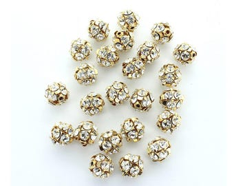 Rhinestone balls 10mm and 12mm made by Preciosa in brass finish.  Price is for four (4) pieces