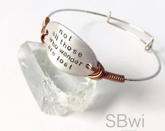 Adjustable, hand-stamped bracelet in stainless steel and aluminum with copper wire wrapped detail