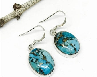 10% Blue mojave copperTurquoise earrings set in sterling silver 92.5. Genuine natural stones. Perfectly matched.
