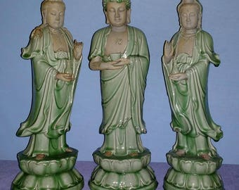 Trio of large Buddhist figures with celadon glaze. Late Yuan Dynasty, or early Ming Dynasty.