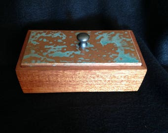 Cherry box with blue-green faux copper patina.