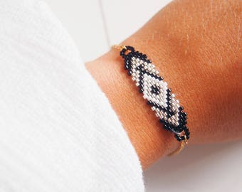 Stainless steel - black and white and gold beaded bracelet-