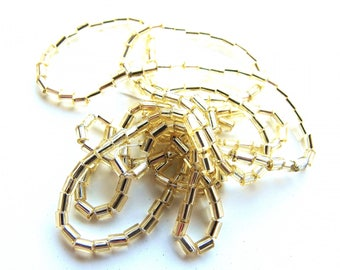 1 STRAND 1/4 TUBES FACETED 40 CM PALE GOLD