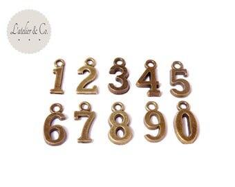 10 Breloques chiffres 0 à 9 8x15mm métal bronze / GQ17
