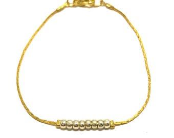 Gold minimalist bracelet, silver round beads