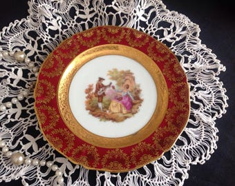 Fragonard lovers cabinet plate. Limoges.  Signed.  Ruby red.