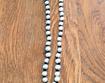 Gray freshwater pearl necklace, hand knotted with black suede and finished with a black suede tassel