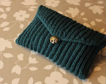 Calfskin clutch in hand for Mrs., woven to