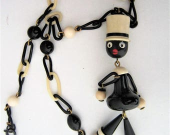 Vintage celluloid necklace with figural dandling boy ,France 1930