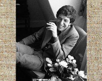 Leonard Cohen smiling, smoking and with flowers. black and white photo print, vintage photograph, rock music decor, gift for him or her