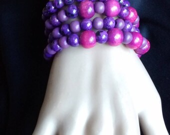 Bracelet with pink and purple beads on memory wire