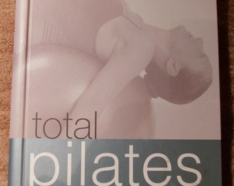 Total Pilates by Malcolm Muirhead 185 pages Spiral Bound Hard Cover