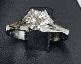 18k white gold solitaire ring with 0.65 carat brilliant cut diamond