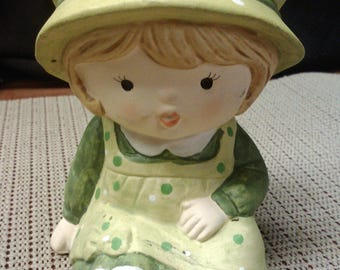Girl in green coin bank