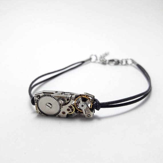 Women bracelet in dark gray leather with antique mechanical watch movement
