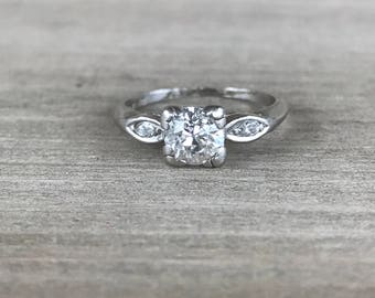 Platinum diamond solitaire with marquise diamond shoulders vintage ring