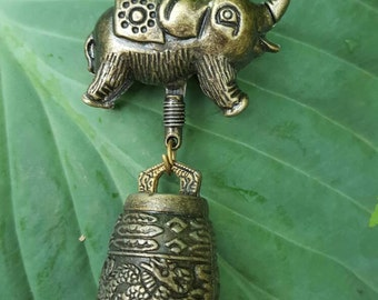 Chinese Feng shui elephant with upturned trunk for good luck - happy elephant bell