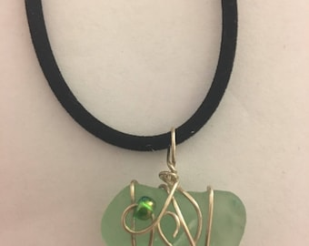 Green sea glass necklace wrapped in silver wire