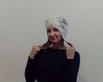 Felted winter curly warm cap with small ears of white and gray color for the stylish lady Designer felted wool cap with ear-flaps