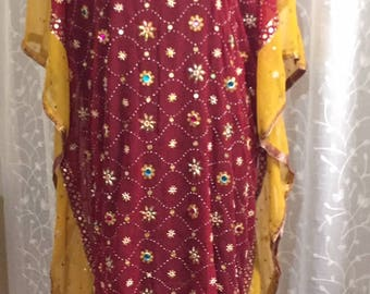 This Dazzling Bejeweled Burgundy and Sunburst Yellow Sheer Caftan is Show Stopping.  Accented with Golden Sequins, Rhinestones and Beads.