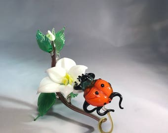 Glass composition ladybug with flower
