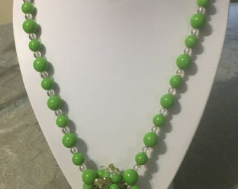 Handmade single strand necklace with green and clear beads and center cluster