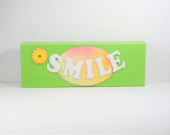 Smile - Designed as a cute reminder to show your happy side.  Customizable for color, font, or background, just ask us!