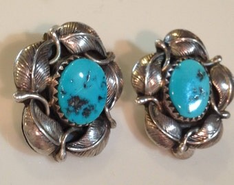 vintage navajo turquoise five feather sterling silver clip on earrings. circa 1970's