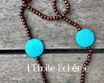 Necklace made of wood with turquoise round medallions