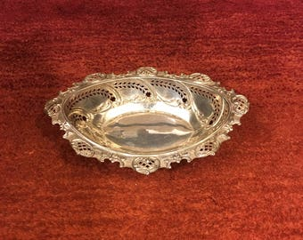 Sterling Silver bonbon/nut dish hallmarked on rim with pierced,cage and repousse work