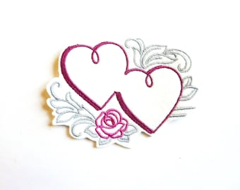 Fusible intertwined hearts