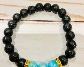 Bracelet in black lava beads and turquaze beads