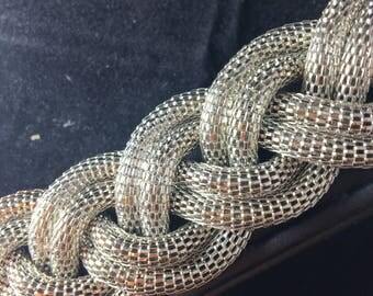 silver metal bracelet with interlaced links