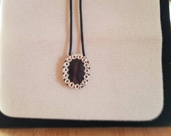 Black cabochon with chainmaille bezel