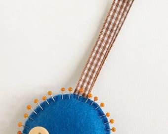 Blue felt lion pincushion