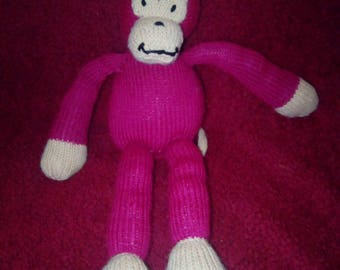 """Monkey Teddy. Burgandy. 11.5"""" tall. Knitted in Aran."""