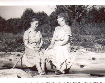 The Chat, 1940's Snapshot of Two Ladies Sitting on a Log at Beach, Found Photograph