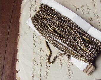 LAST ONE - 1970s rhinestone chain - gold tone brass with clear glass stones and vintage tarnish - 2 metres