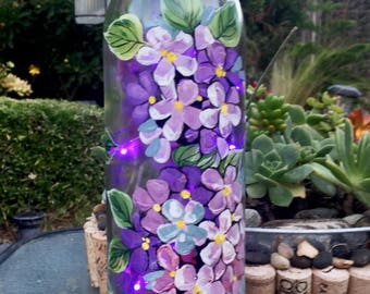 Hydrangeas lighted wine bottle