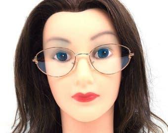 90s eyeglasses. deadstock vintage. 1990s. oval eyeglasses. gold demi. 51[]17 135mm. brown plastic. tortoise shell. oval glasses. vintage 243