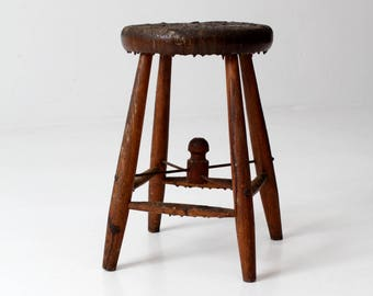 antique primitive wooden stool, milking stool with wire stretcher
