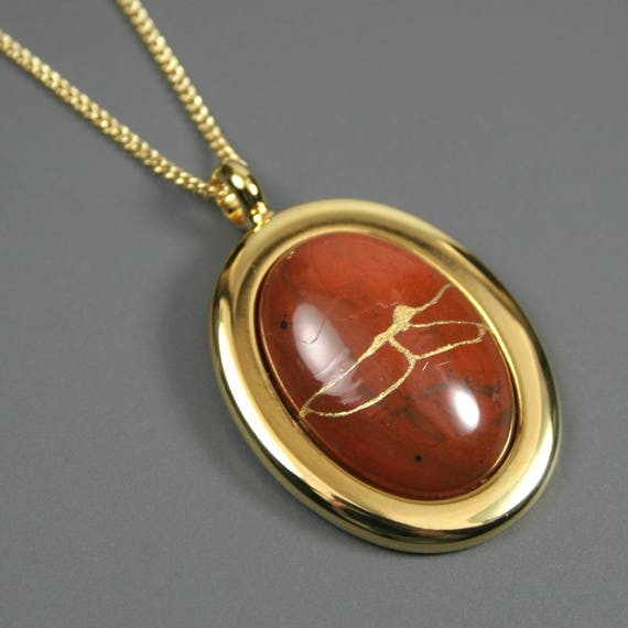 Kintsugi (kintsukuroi) red jasper stone cabochon with gold repair in a gold plated setting on gold chain - OOAK