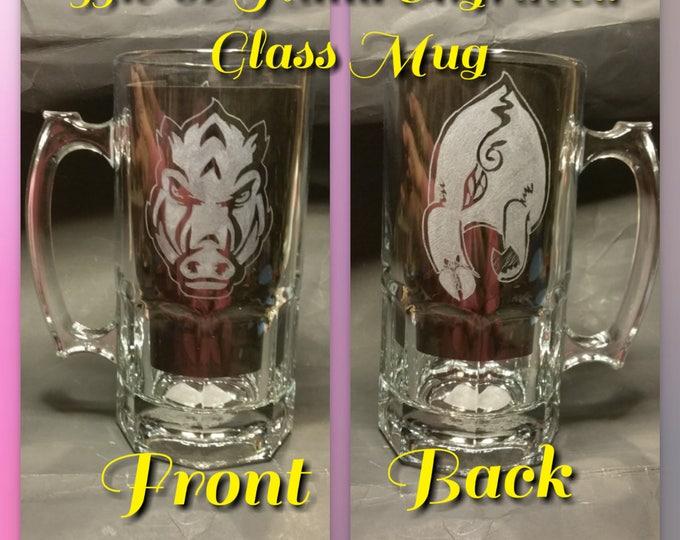 Hand engraved 33.8 oz glass mug with the forward facing Arkansas Razorback Logo and backside of hog